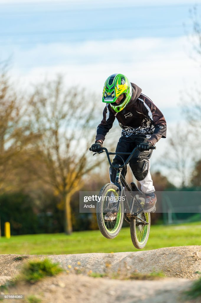 Teenager jumping with his BMX bike.