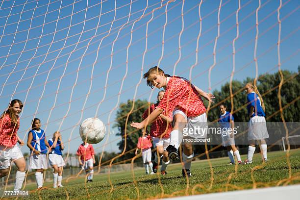 Teenager Kicking Soccer Goal