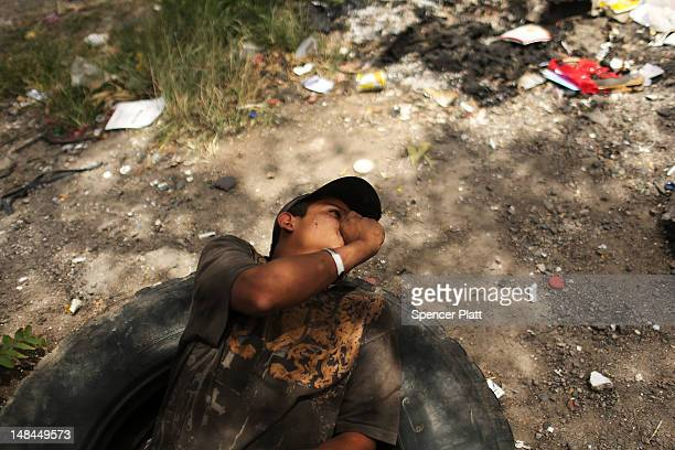 A teenager living on the street sniffs paint thinner which he and his friends use to get high on July 16 2012 in Tegucigalpa Honduras Honduras now...
