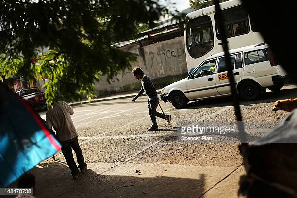A teenager living on the street who is addicted to sniffing paint thinner walks with a crutch on July 17 2012 in Tegucigalpa Honduras Honduras now...