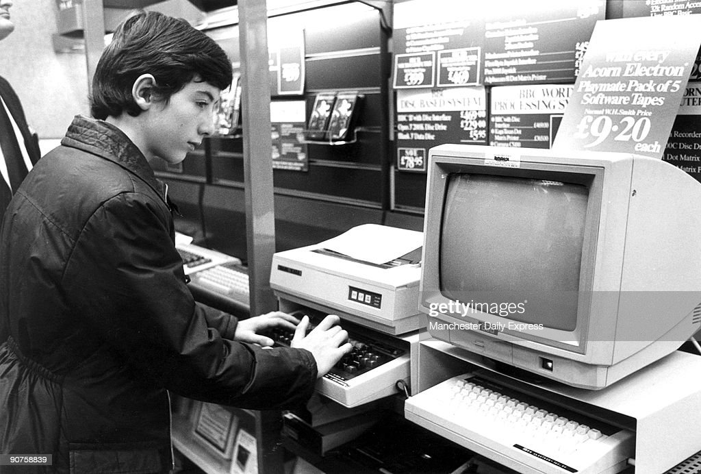 Boy looking at a computer, WH Smith, December 1984. : News Photo