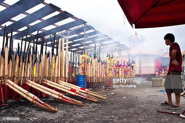 Teenager looking on at the big incense sticks that is burning during the annual Nine Emperor Gods Festival at Kau Ong Yah Temple, Ampang, Kuala...