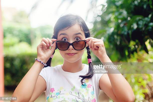 teenager looking over sun glasses
