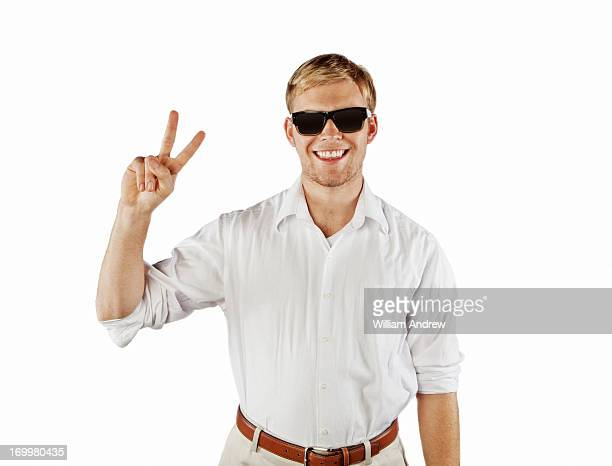 Teenager making 'peace' sign wearing sunglasses