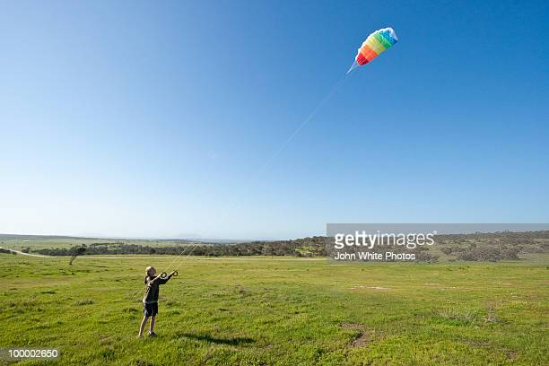 Teenager male flying a kite
