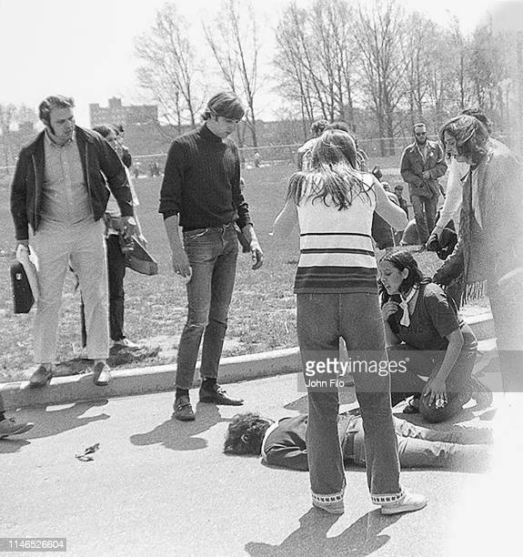 Teenager Mary Ann Vecchio and others surround the body of Kent State University student Jeffrey Miller who had been shot during an antiwar...