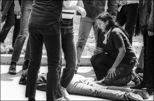 Teenager Mary Ann Vecchio kneels over the body of Kent State University student Jeffrey Miller who had been shot during an anti-war demonstration on...