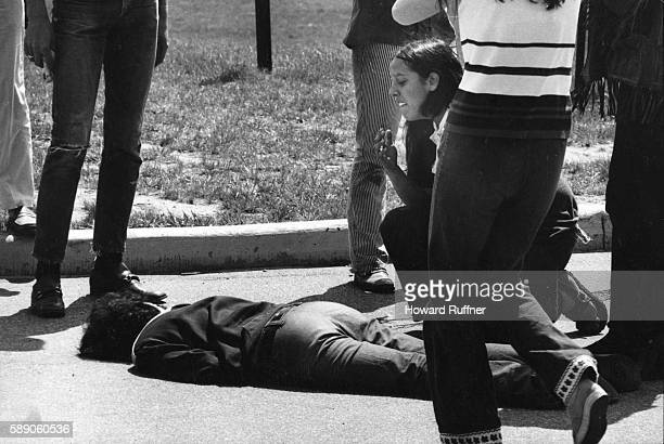 Teenager Mary Ann Vecchio kneels over the body of Kent State University student Jeffrey Miller who had been shot during an antiwar demonstration on...