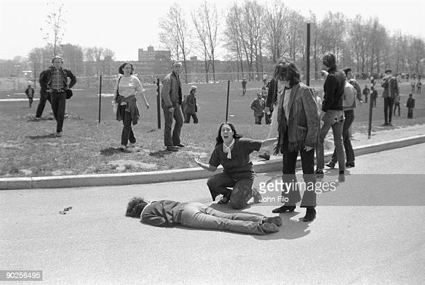Teenager Mary Ann Vecchio screams as she kneels over the body of Kent State University student Jeffrey Miller who had been shot during an anti-war...