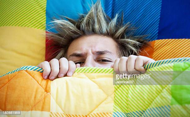 teenager not wanting to get out of bed - teenagers only stock pictures, royalty-free photos & images