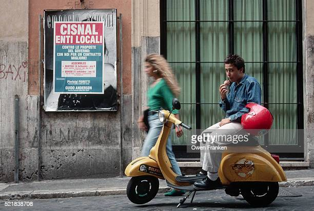 teenager on a moped eating an ice cream cone - mobylette photos et images de collection