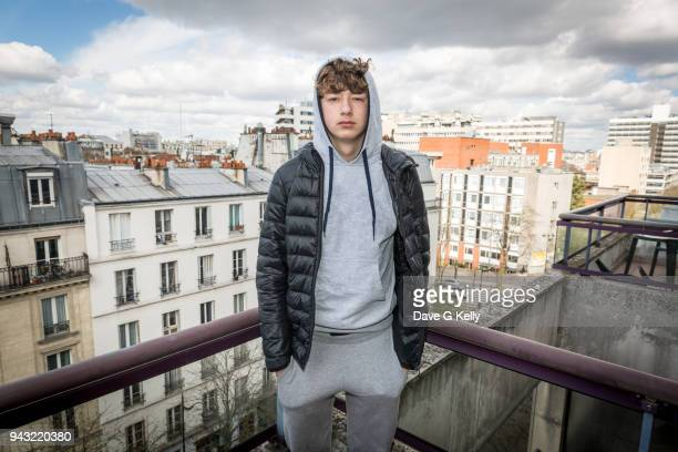 teenager on a rooftop balcony - hood clothing stock pictures, royalty-free photos & images