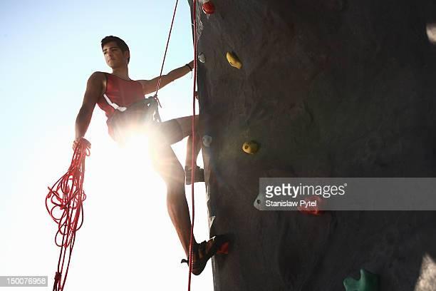teenager on climbing wall looking behind