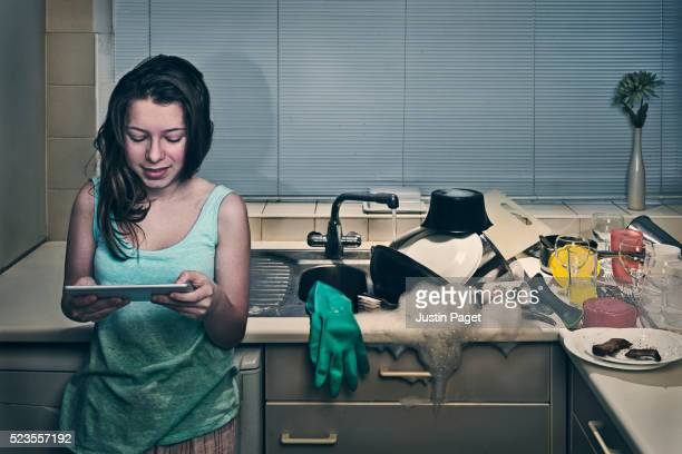 Teenager on Tablet whilst Sink Overflows