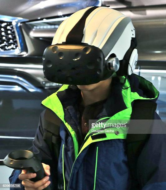 Teenager operating a Virtual Reality headset and controller