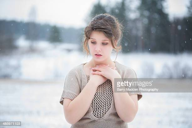 Teenager outside in the winter cold with no jacket