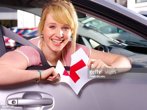 Teenager passing driving test.