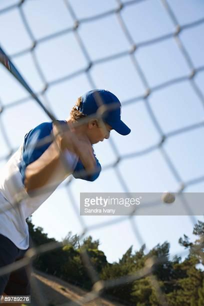 Teenager playing baseball