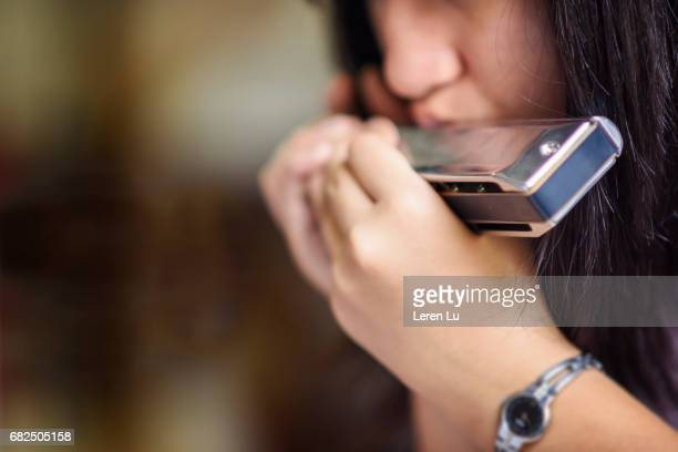 teenager playing harmonica - teenagers only stock pictures, royalty-free photos & images
