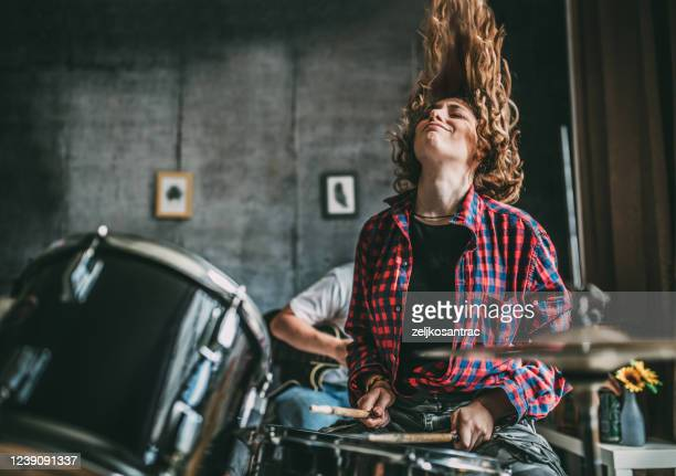 teenager playing rock and roll at home - percussion instrument stock pictures, royalty-free photos & images
