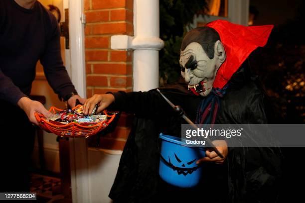 Teenager playing trick or treat in London on Halloween night, U.K.