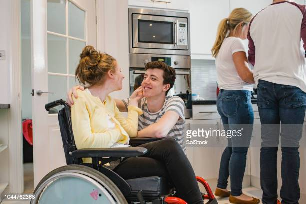 teenager playing with disabled sister at home - epilepsy stock pictures, royalty-free photos & images