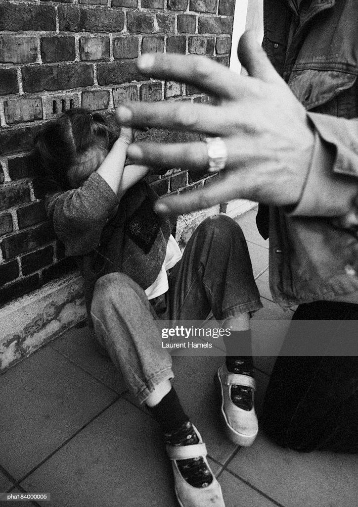 Teenager protecting self from assailant, close-up, b&w : Stockfoto
