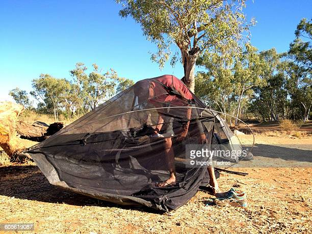teenager setting up his tent - struggle stock pictures, royalty-free photos & images