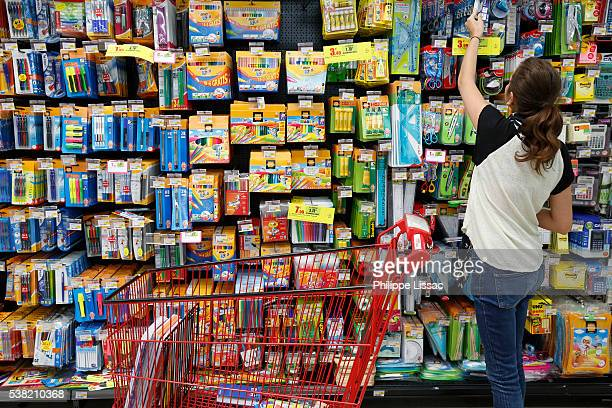 teenager shopping for school supplies in a supermarket - school supplies stock pictures, royalty-free photos & images
