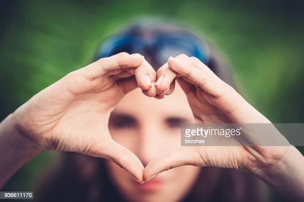 Teenager Showing Love Sign
