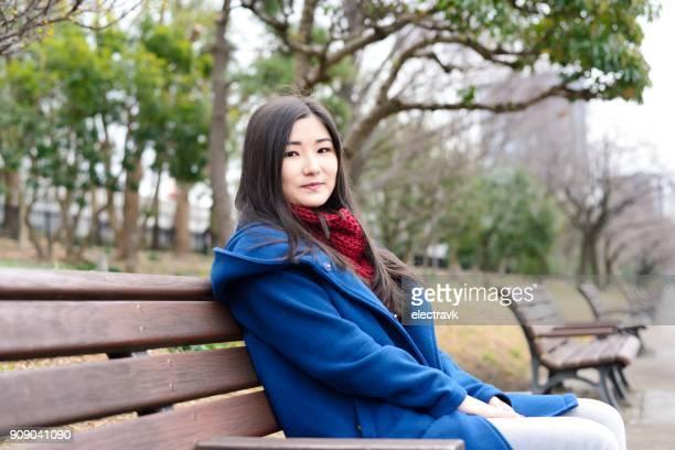 Teenager sitting outside
