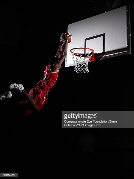 teenager soaring in the air to make a shot - making a basket scoring stock photos and pictures