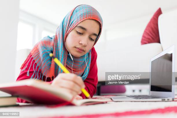 Teenager student studying at home