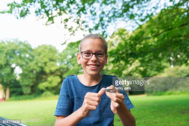 Teenager using fidget spinner