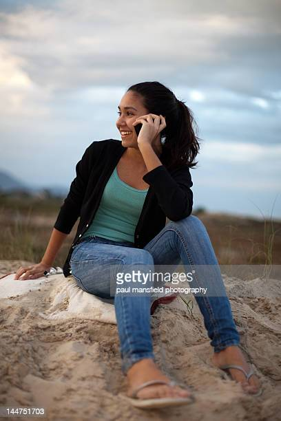 Teenager using mobile phone outdoors