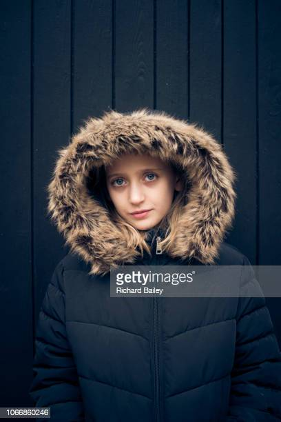 Teenager wearing a parka coat