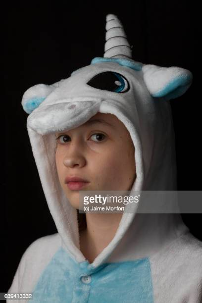 Teenager wearing a unicorn costume