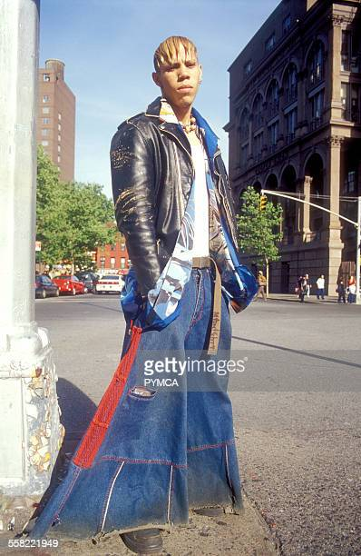 A teenager wearing baggy flared jeans and a leather jacket Astor Place New York USA 2002