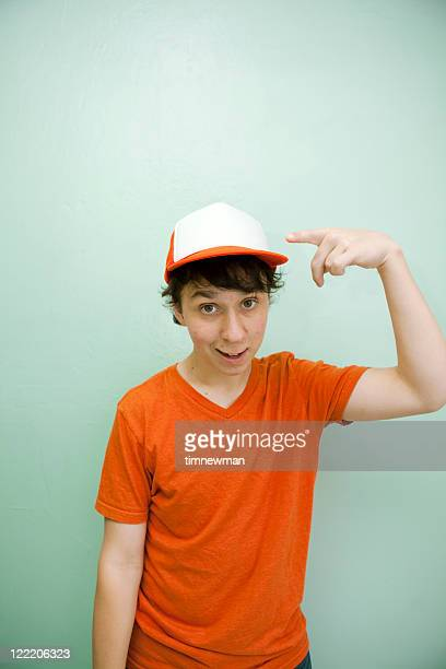 teenager wearing blank orange t-shirt and hat - trucker's hat stock pictures, royalty-free photos & images
