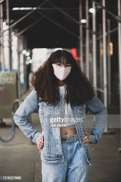 teenager wearing protective face mask in new york city - cloth mask stock pictures, royalty-free photos & images
