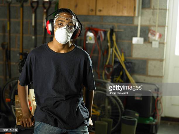 Teenager wearing protective mask and goggles