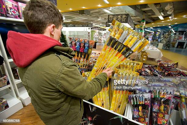 Teenager when purchasing rockets fireworks in a department store in Bonn on December 29 2014 in Bonn Germany