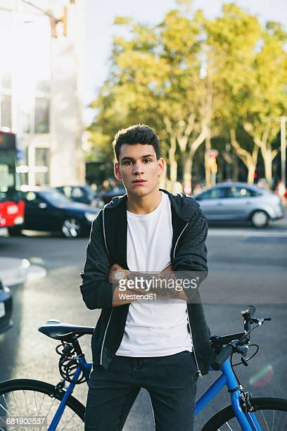 Teenager with a fixie bike in the city