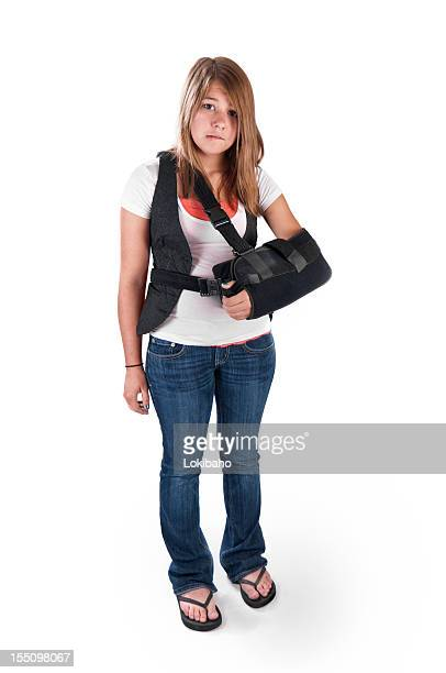 teenager with arm sling - girl wear jeans and flip flops stock photos and pictures