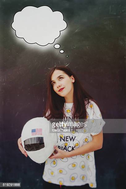 teenager with astronaut helmet dreaming to be