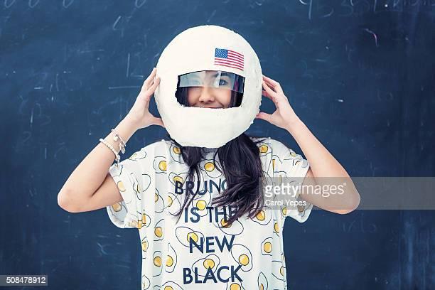 teenager with astronaut helmet