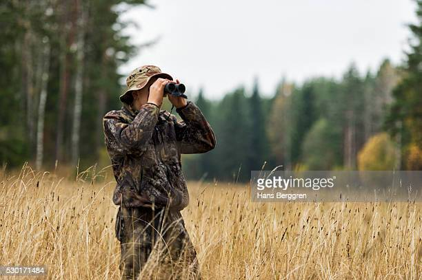 teenager with binoculars watching forest - hunting stock pictures, royalty-free photos & images