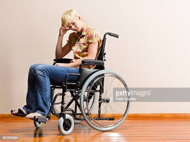 teenager with depression in wheel chair - leaning disability stock pictures, royalty-free photos & images
