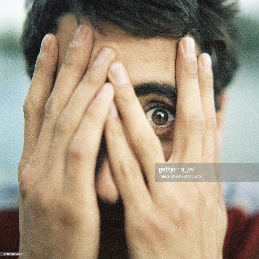 Teenager with hands on face : Stockfoto