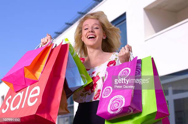 teenager with sales shopping bags - carefree stock pictures, royalty-free photos & images